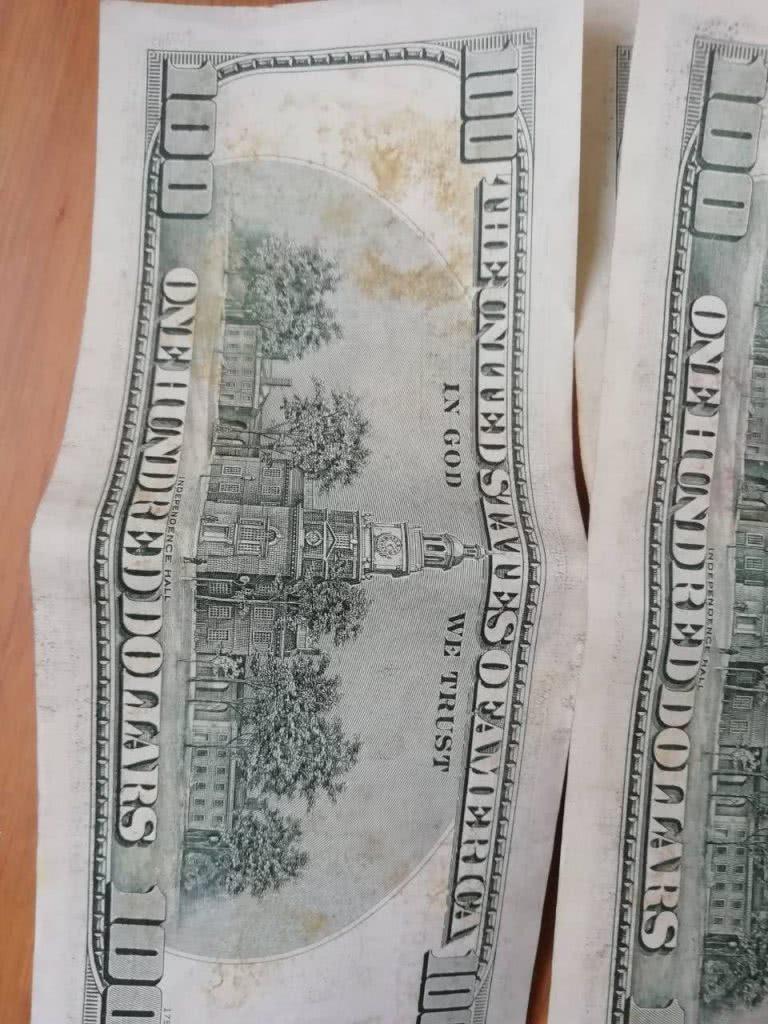 испорченные 100 долларов, другой вид сторона
